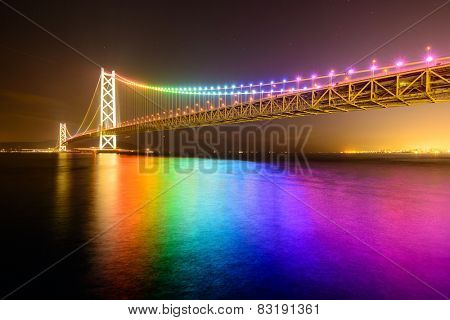 Rainbow lights on Akashi Ohashi (Pearl Bridge) in Kobe, Japan.