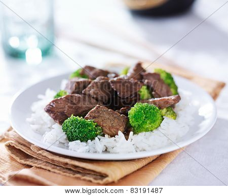 chinese food - beef stir fry with broccoli and rice