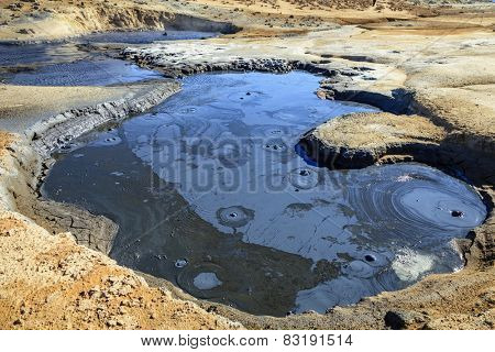 Boiling mud pool in Hverir - geothermal field in Northern Iceland
