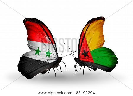 Two Butterflies With Flags On Wings As Symbol Of Relations Syria And Guinea Bissau