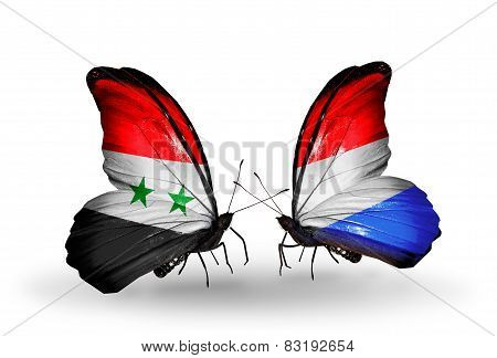 Two Butterflies With Flags On Wings As Symbol Of Relations Syria And Luxembourg