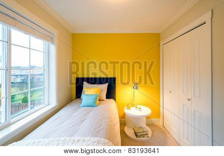 Modern yellow bedroom interior.