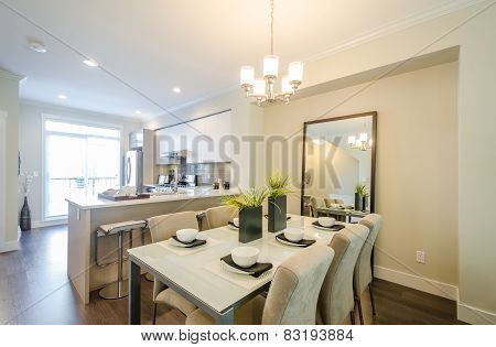 Modern dining room with kitchen in a luxury apartment.