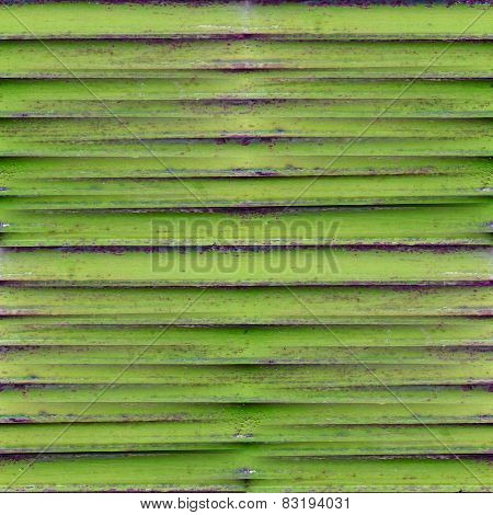seamless green grunge texture of old iron shutters ventilation