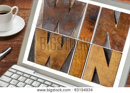 win-win - negotiation or conflict resolution strategy  -  words in letterpress wood type on a laptop screen with a cup of coffee