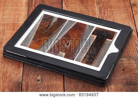 VAT (value added tax) - text in letterpress wood type printing blocks on a digital tablet