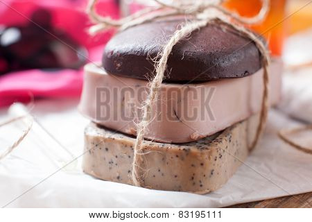 Closeup Of Three Of Natural Handmade Soap. Chocolate, Orange And Scrub Soaps