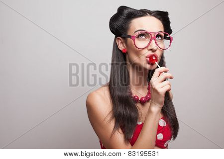 Pin Up Styling Girl Eating Lollipop