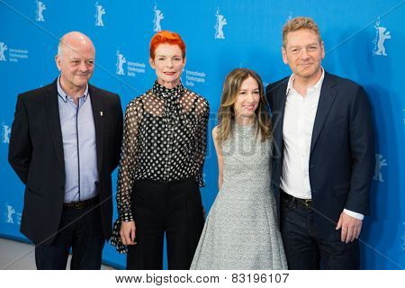 BERLIN, GERMANY - FEBRUARY 13: A. Shearmur, S. Powell, Kenneth Branagh, 'Cinderella' photocall.65th Berlinale International Film Festival at Grand Hyatt Hotel on February 13, 2015 in Berlin, Germany