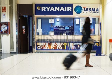 VALENCIA, SPAIN - FEBRUARY 14, 2015:  A Ryanair customer service counter at the Valencia airport. In 2014, Ryanair was the largest European airline by scheduled passengers carried.