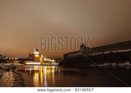 The medieval fortress Ivangorod and German, night landscape, river Narva