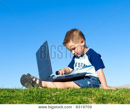 child playing on laptop computer