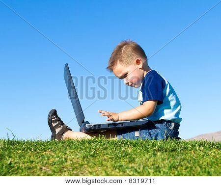 child with notebook sit under blue sky
