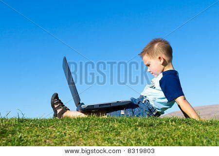 boy with notebook sit under blue sky