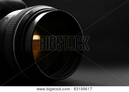 Digital camera on dark background