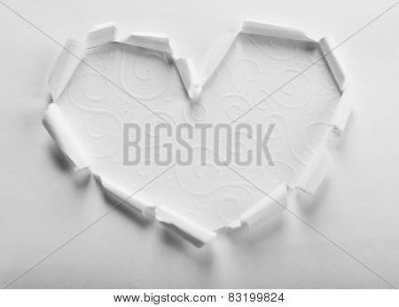 Torn paper heart over white background