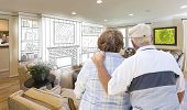 picture of combinations  - Senior Couple Looking Over Custom Living Room Design Drawing and Photo Combination - JPG