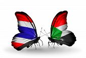 foto of sudan  - Two butterflies with flags on wings as symbol of relations Thailand and Sudan - JPG