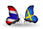 picture of sweden flag  - Two butterflies with flags on wings as symbol of relations Thailand and Sweden - JPG