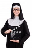 pic of nun  - Young nun with clapperboard isolated on white - JPG