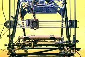 stock photo of open-source  - Open Source Three dimensional printer Printing with Plastic Wire - JPG