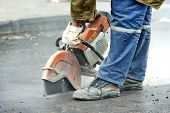 stock photo of paved road  - Builder worker with cut - JPG