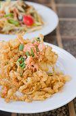 foto of crispy rice  - fried crispy beaten egg omelette served with steamed rice - JPG