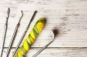 picture of lollipop  - Dentist tools with lollipop on wooden background - JPG