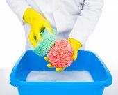 stock photo of metaphor  - Metaphor of brainwashing doctor washes the brain with the sponge - JPG