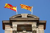 image of coexist  - Flags of Spain and Catalonia together atop Parliament of Catalonia - JPG