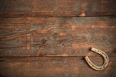 picture of horseshoe  - Lucky horseshoe on old wooden background - JPG