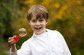 boy having fun with soap bubbles