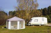 stock photo of trailer park  - Rest of a auto tourists in the autumn wood landscape - JPG