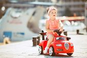 image of car ride  - Cute little girl with chestnut colored hair and short hair - JPG
