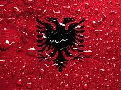 pic of albania  - a flag of Albania with rain drops - JPG