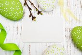 stock photo of easter card  - Easter greeting card with easter eggs on a old wooden background - JPG