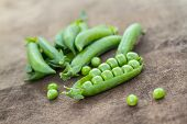 stock photo of sweet pea  - Fresh Homemade Peas On The Wooden Background - JPG