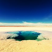 stock photo of andes  - Ojo del Mar in Argentina Andes is a salt desert in the Jujuy Province - JPG
