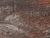 stock photo of sedimentation  - old rough brown wooden board bleached by time and street sediments - JPG