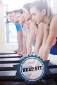 picture of step aerobics  - The word keep fit and instructor with fitness class performing step aerobics exercise against badge - JPG