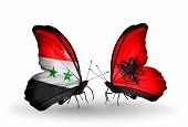 foto of albania  - Two butterflies with flags on wings as symbol of relations Syria and Albania - JPG