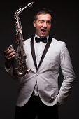 pic of saxophone player  - Winking happy sax player - JPG