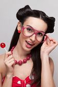 picture of pinup girl  - Face of pinup girl with candy and sunglasses - JPG