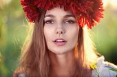 stock photo of glorious  - Closeup face of Ukrainian female model with flower bouquet - JPG