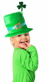 image of shamrocks  - Happy smiling two year old girl wearing a St Patrick - JPG
