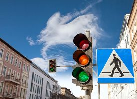 picture of traffic signal  - Traffic lights and pedestrian crossing sign in a city - JPG