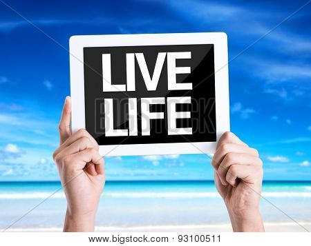 Tablet pc with text Live Life with beach background