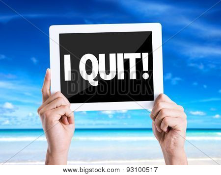 Tablet pc with text I Quit with beach background