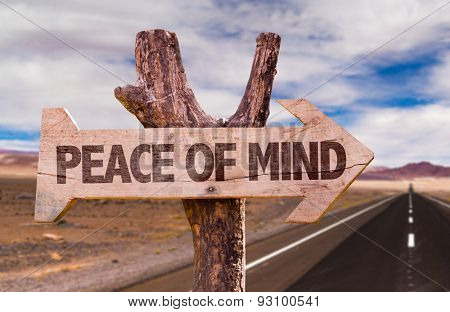 Peace of Mind direction sign with road background