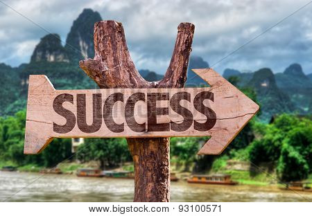 Success direction sign with exotic background